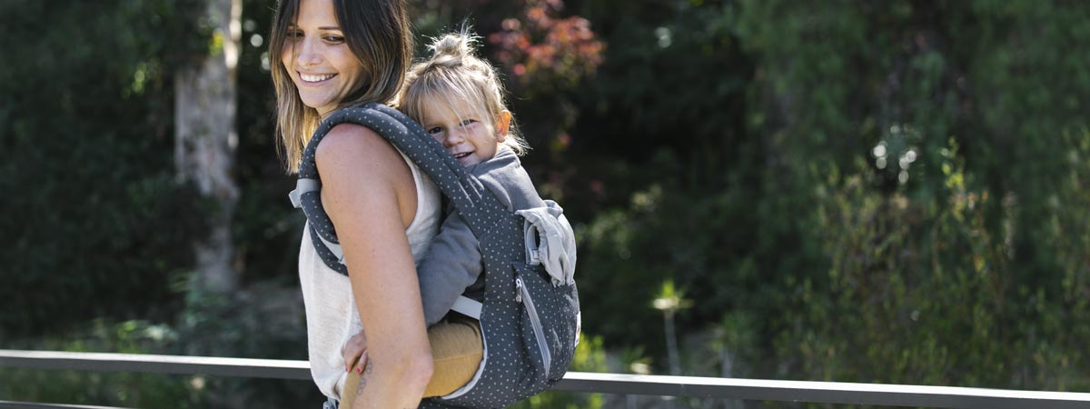Mom carrying baby in an Ergobaby Original Baby Carrier